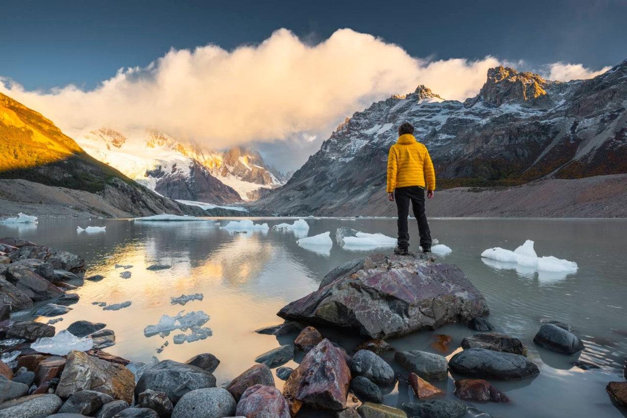 Man looking across lake