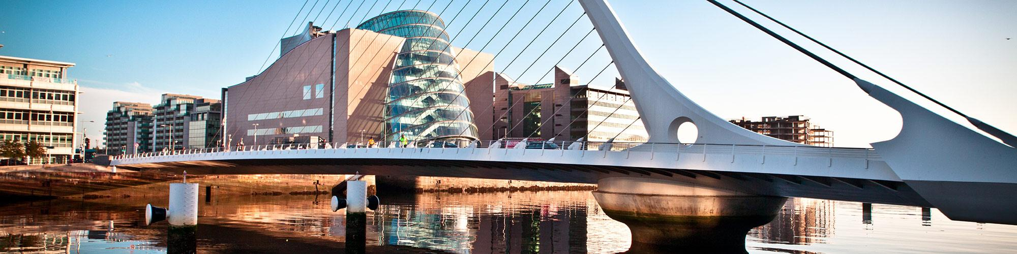 Image of the Samuel Beckett Bridge over the River Liffey in Dublin Ireland with the Convention Centre in the background.