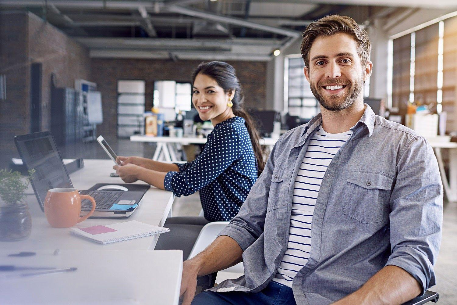 Young man and young woman in an office