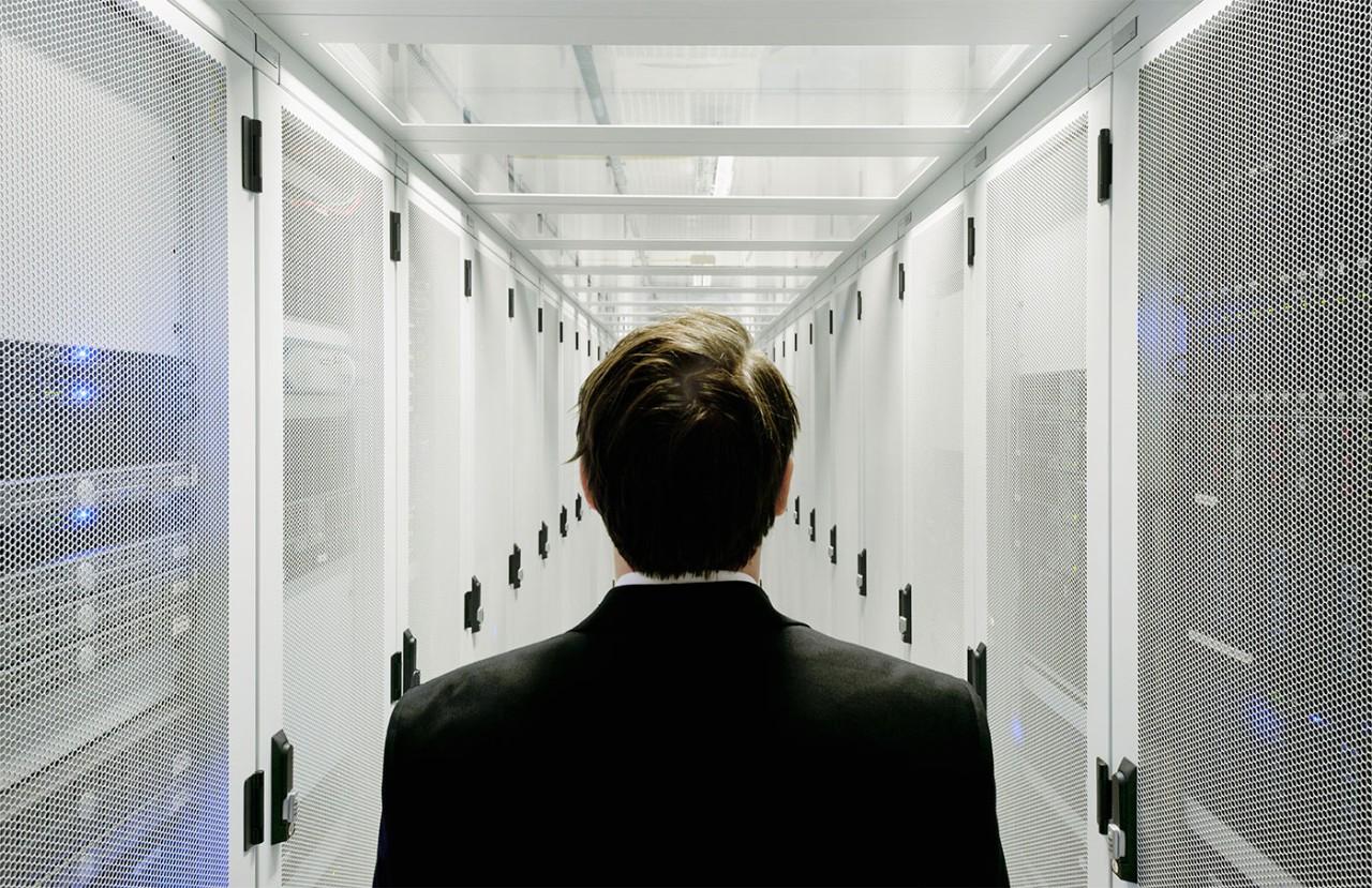 Businessman walking in server room