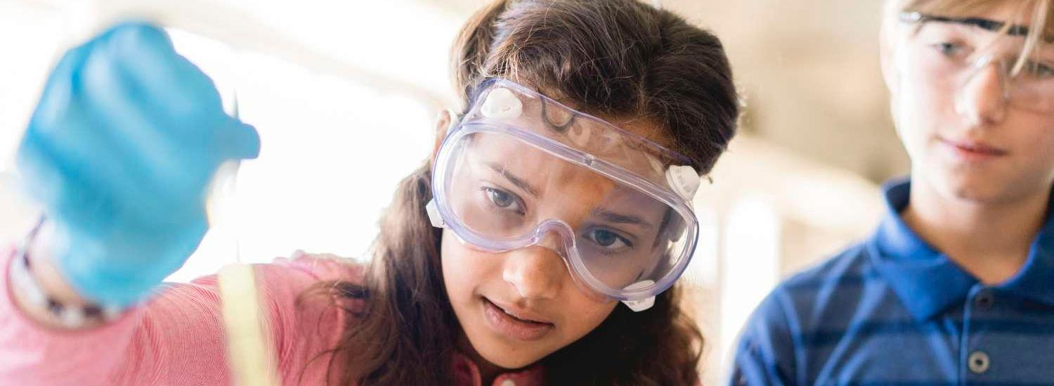 Middle school female student working on a science project