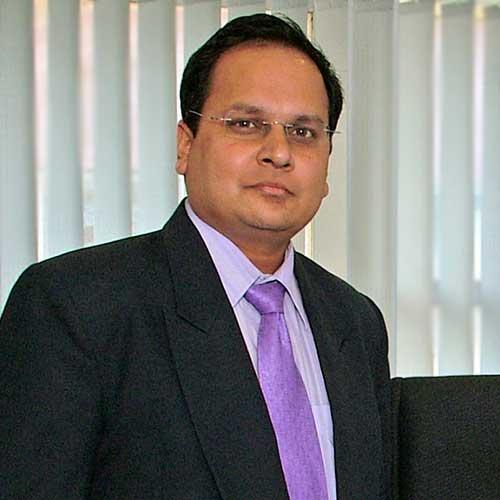R Venkattesh standing in front of window