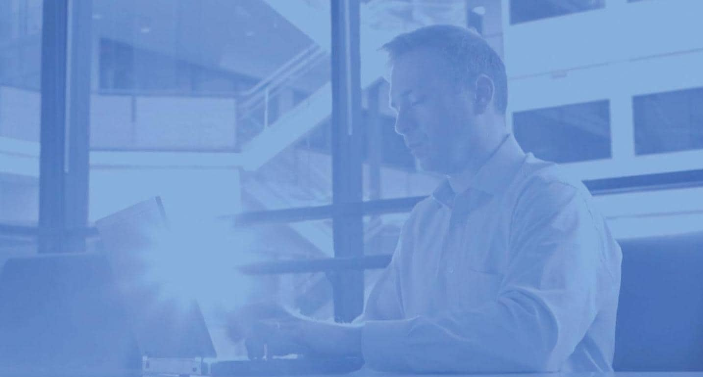 Man on laptop with blue overlay effect