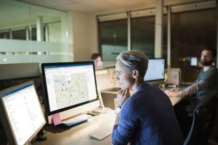 Women Concentrating on Computer using SAS Intelligence and Investigation Management sofware