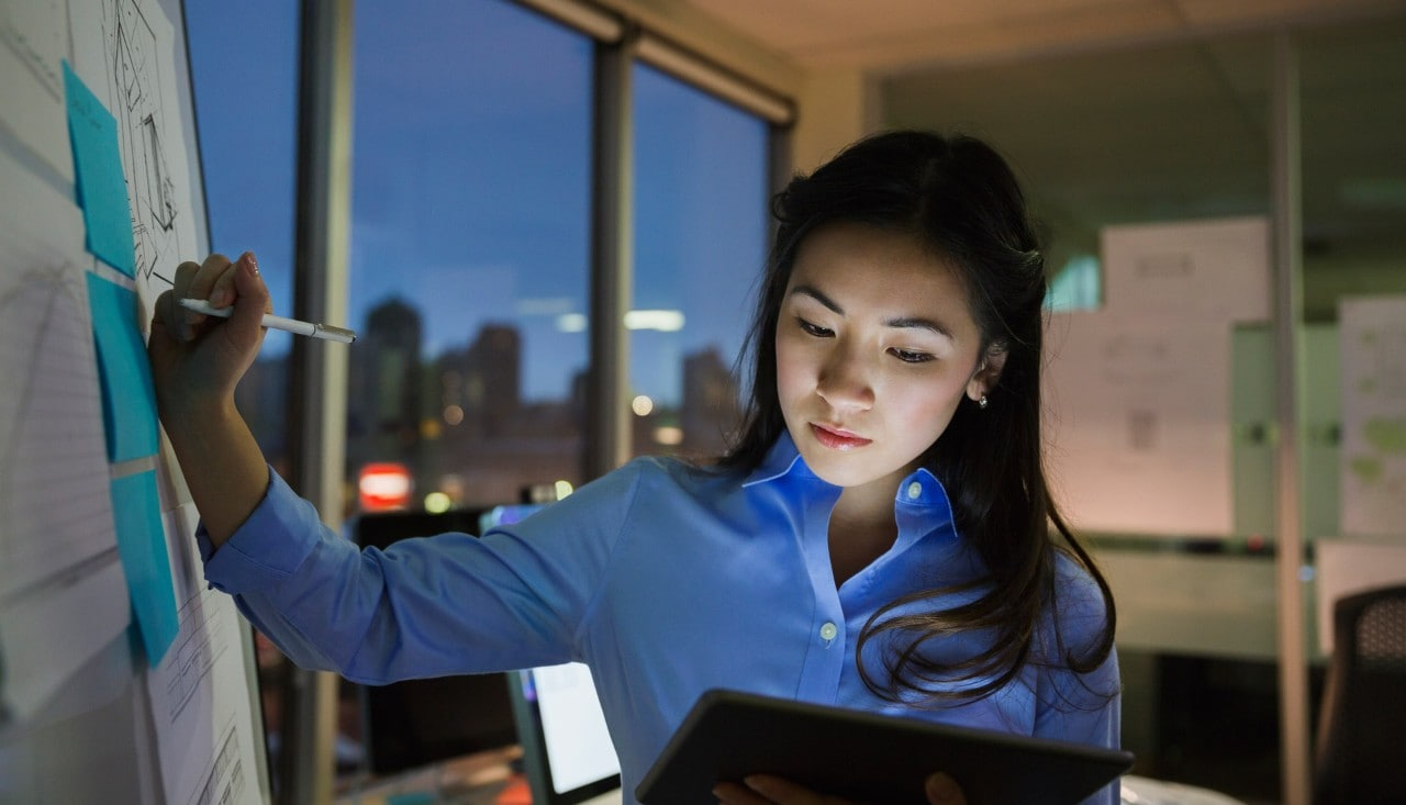 Asian woman working late