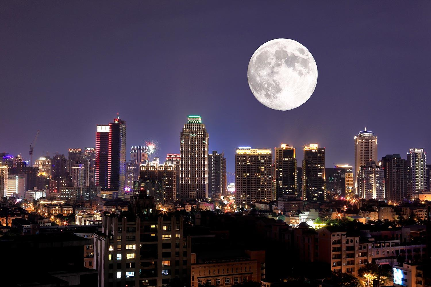 Full moon over city of Taichung Taiwan