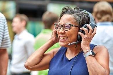 Smiling SAS employee listening to headset