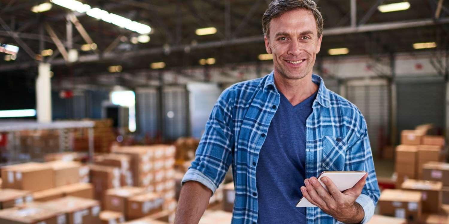 Warehouse worker holding a tablet