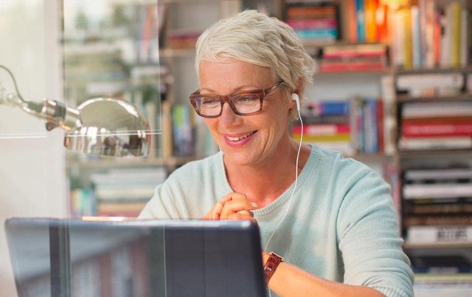 Woman with laptop in a library