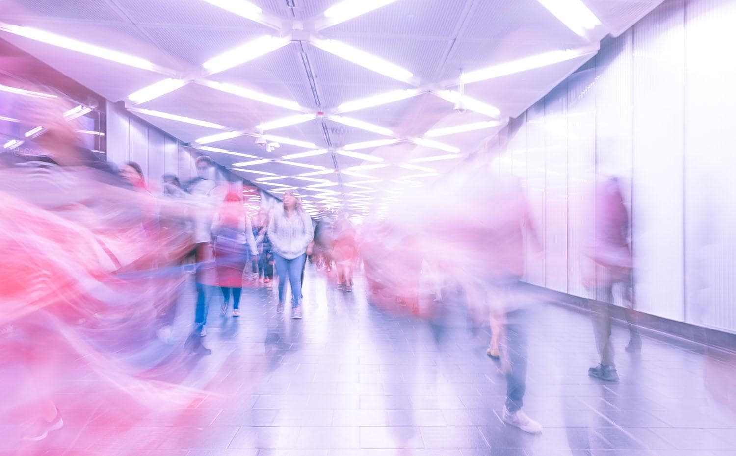 Time lapse photo of commuters on subway