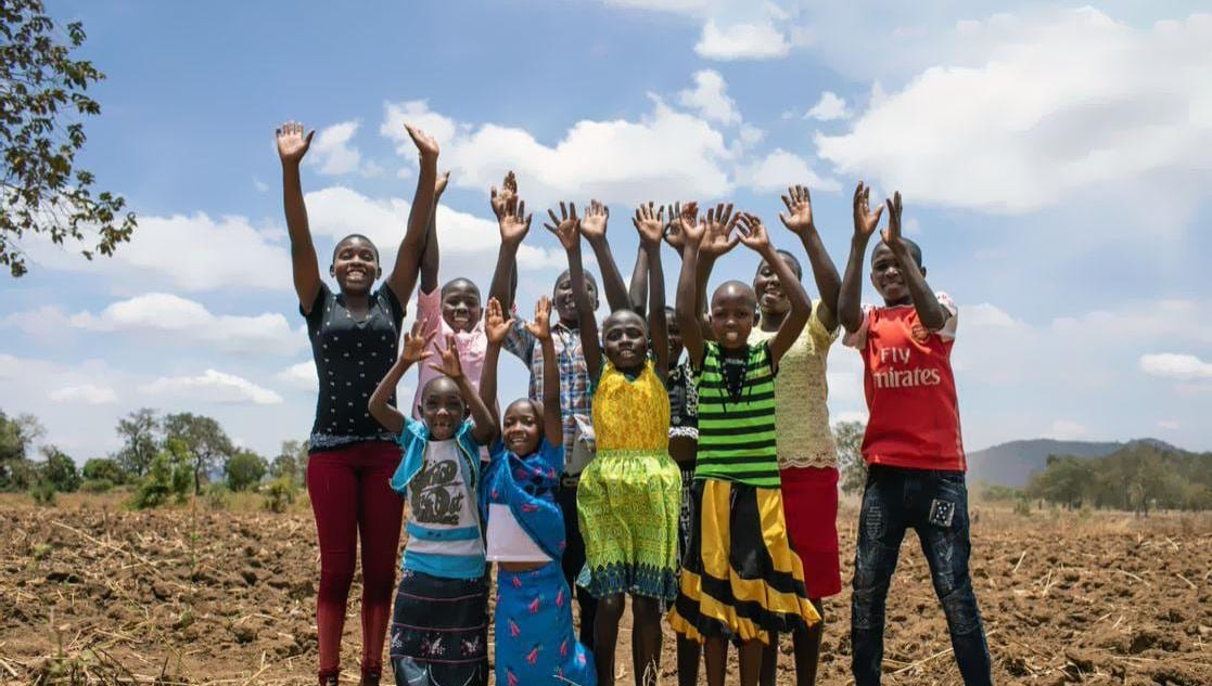 Group of Children Raising arms