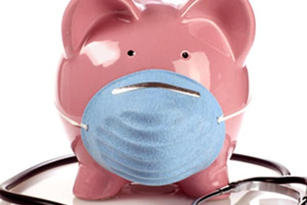 piggy bank with surgical mask and stethoscope