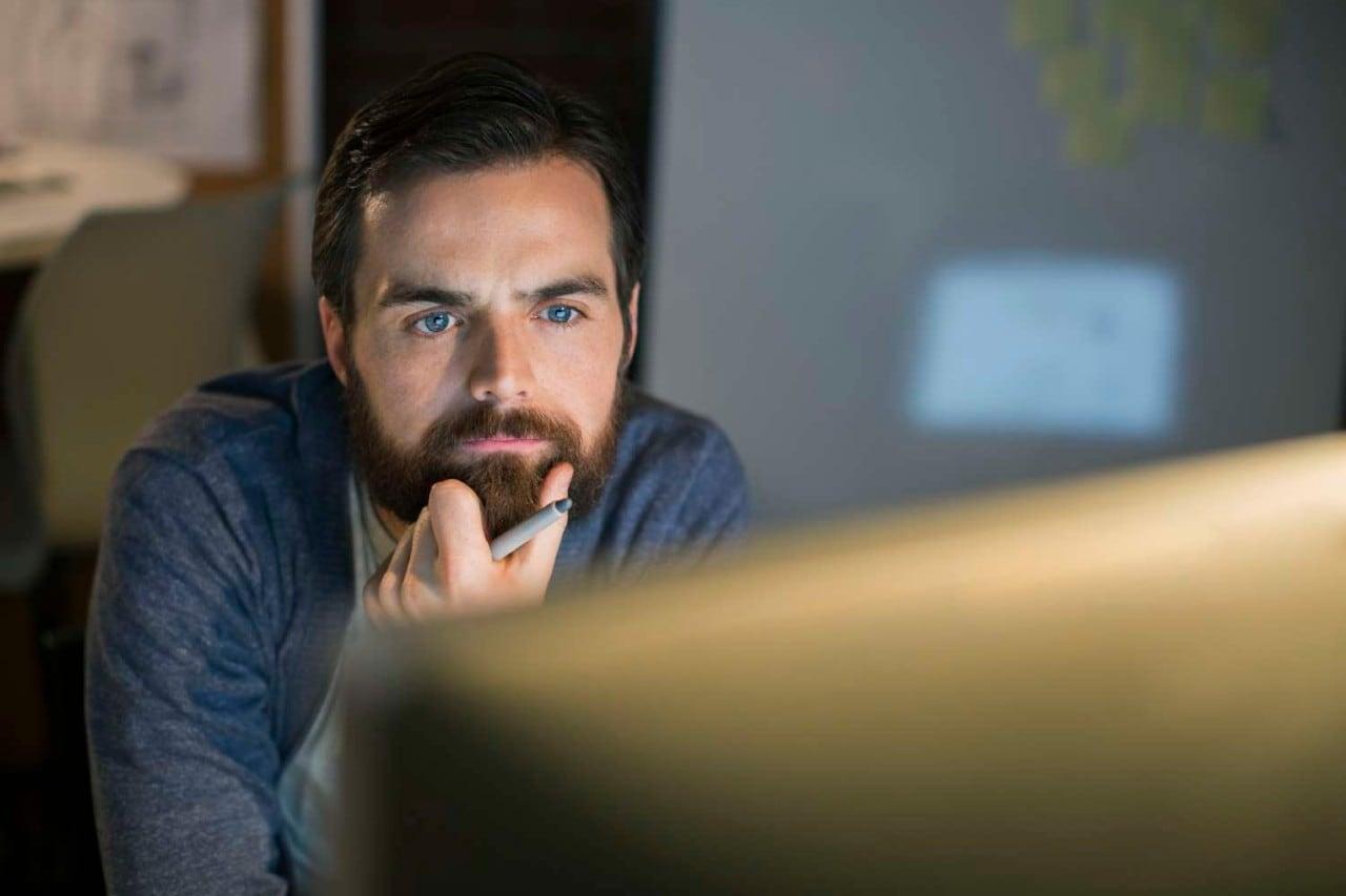 serious man working at computer