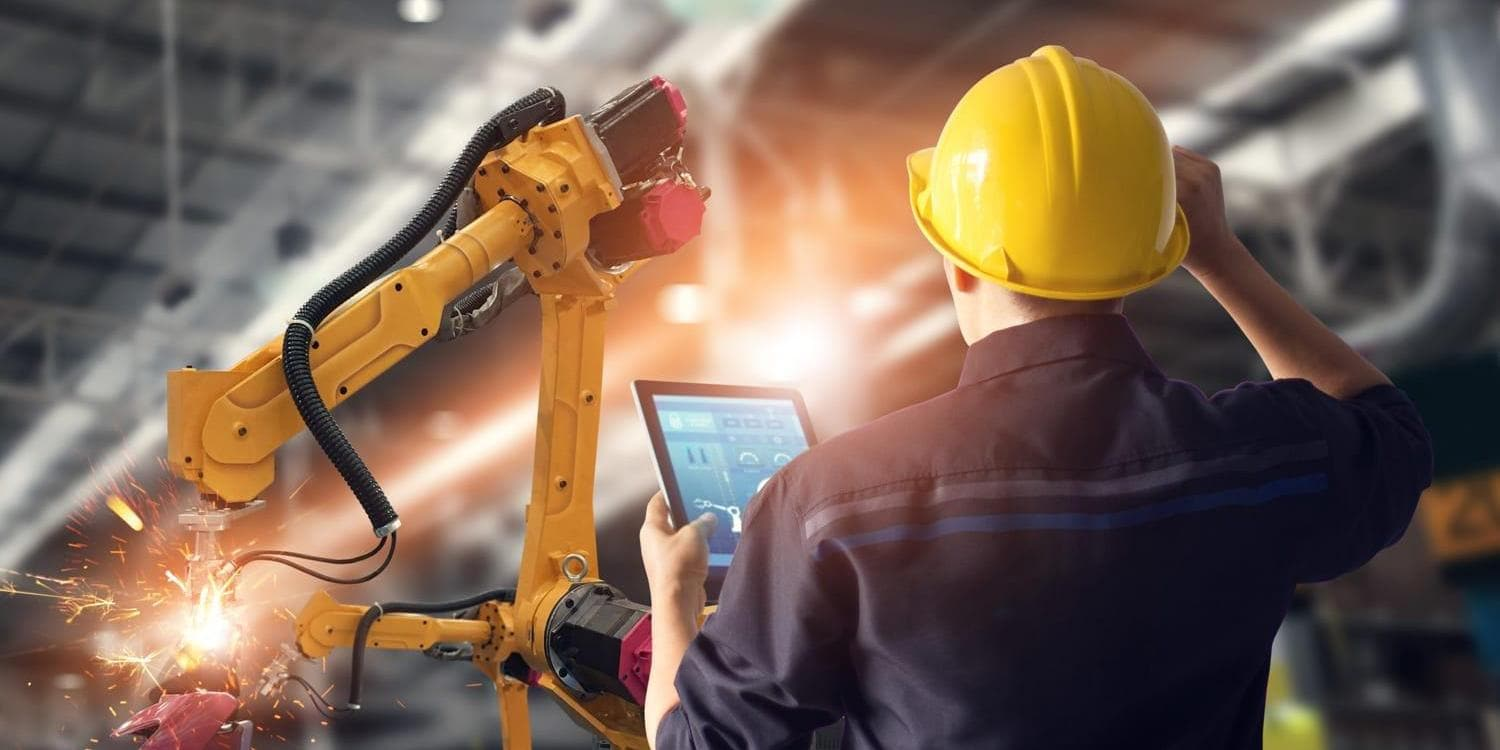 Assembly line worker consulting tablet device