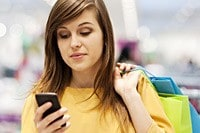 Female shopping with cell phone