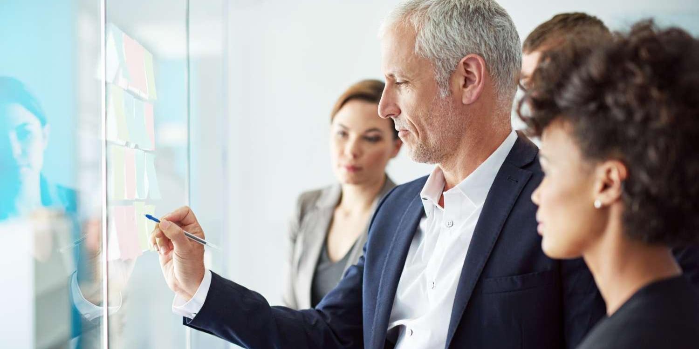 Business man explaining on a screen
