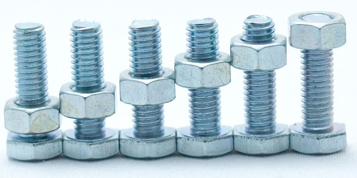 Six nuts with bolts stacked in a row