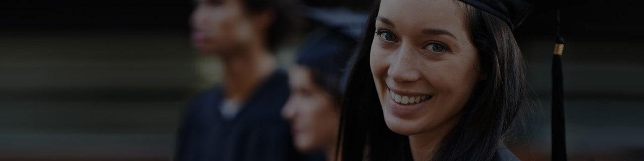 Recent College Graduate Smiling At Camera