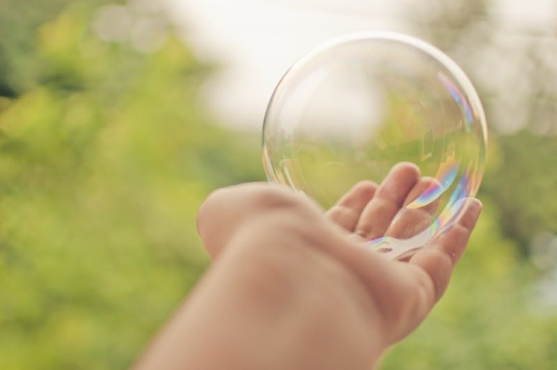 importance of data quality image of hand holding bubble