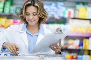 Pharmacist doing inventory at the drugstore