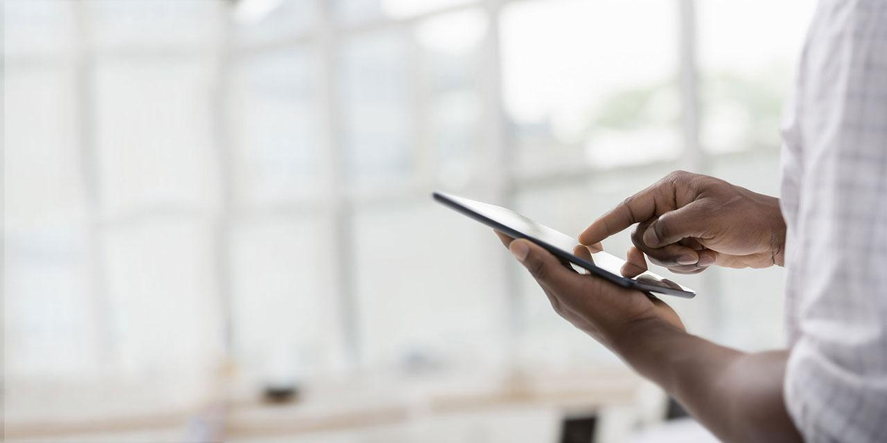 person using a tablet device