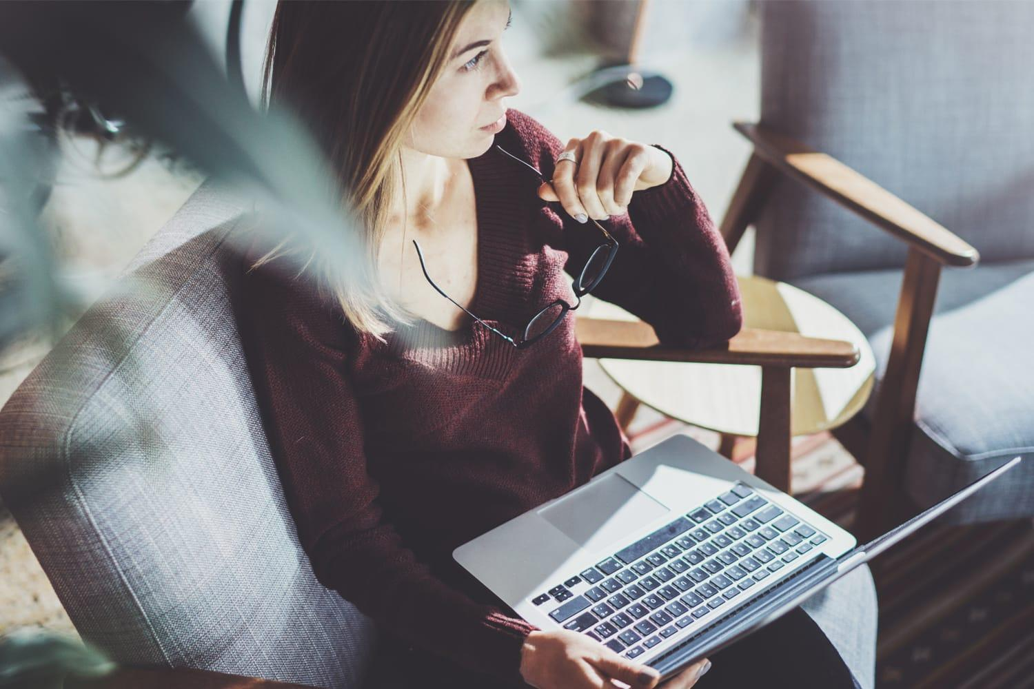 woman sitting in chair with laptop