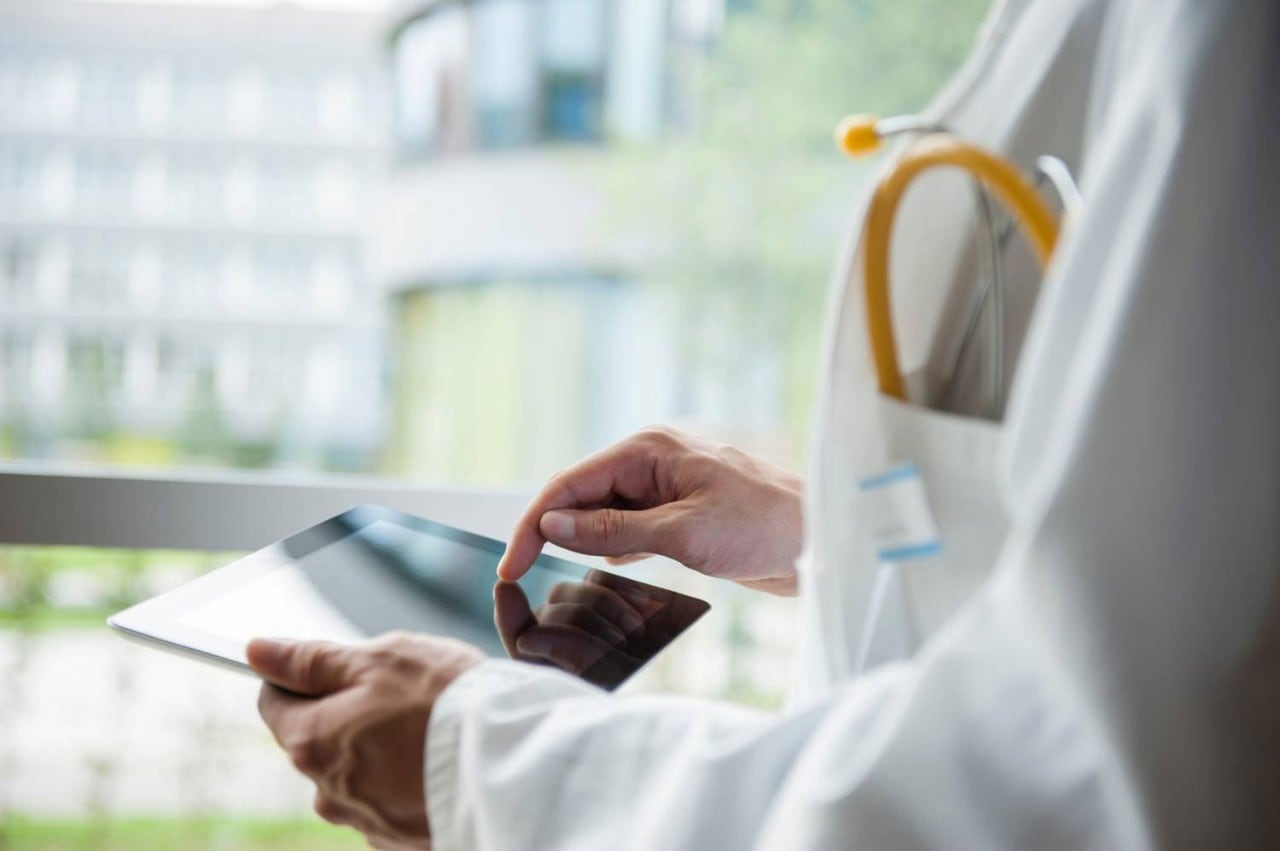 doctors arms with tablet