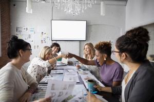Women in Meeting doing a Fist Bump