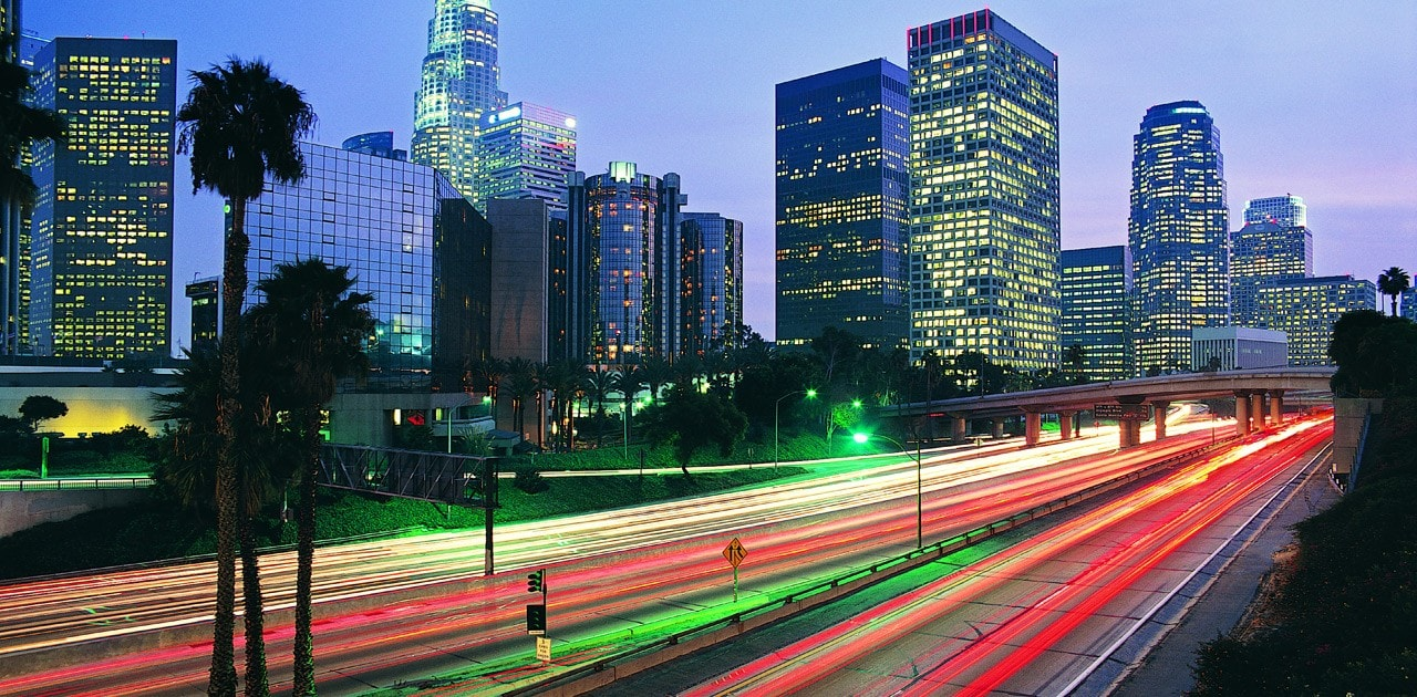 City lights at night, highway and tall buildings