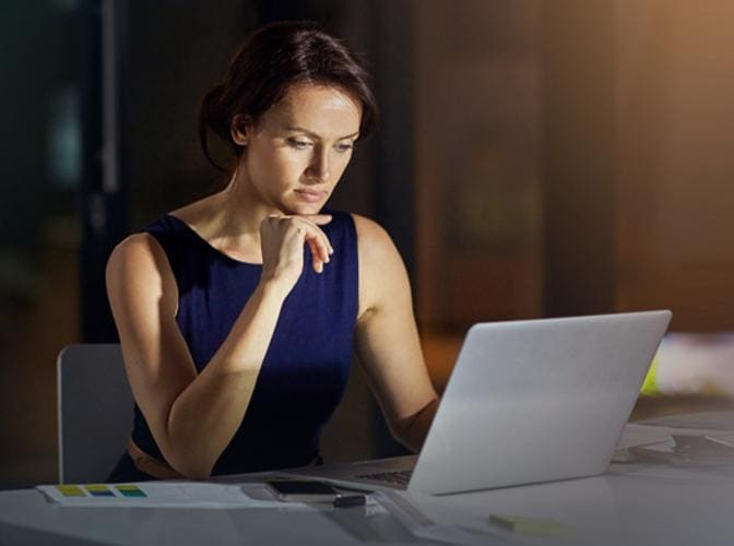 Focused woman looking at the screen of the computer
