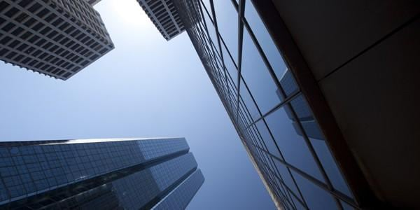 Office buildings and sky seen from street level