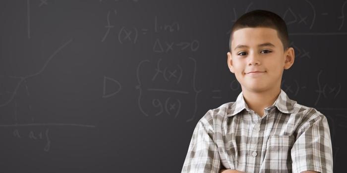 Woman raising hand in classroom