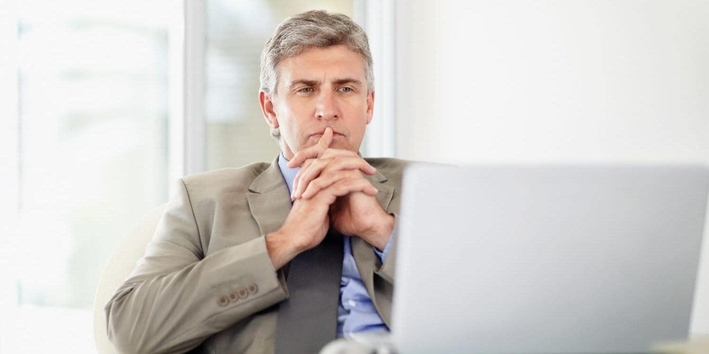 Banker working on laptop