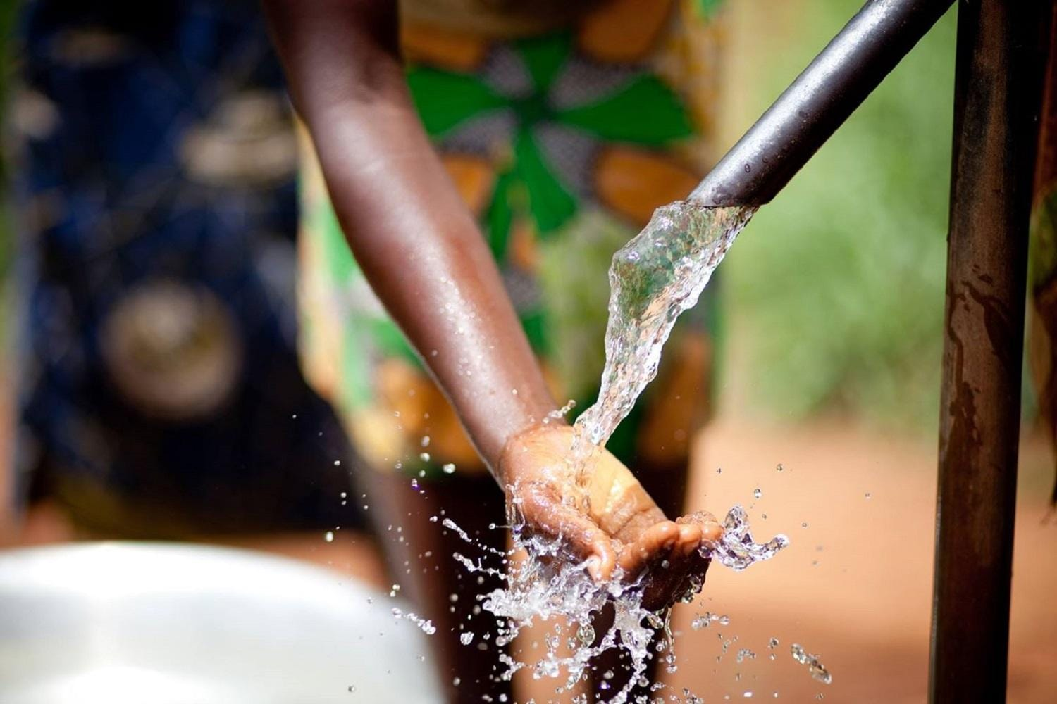 Hand in Water Pump
