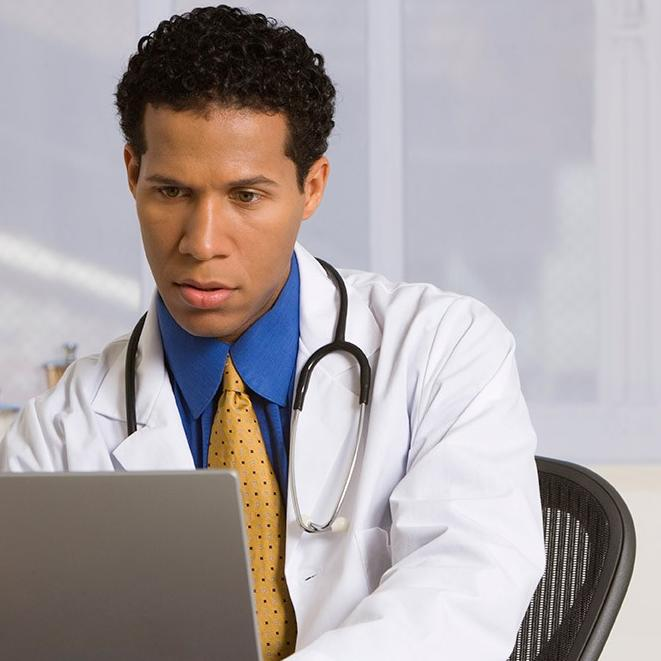 Doctor looking at data on the screen of laptop