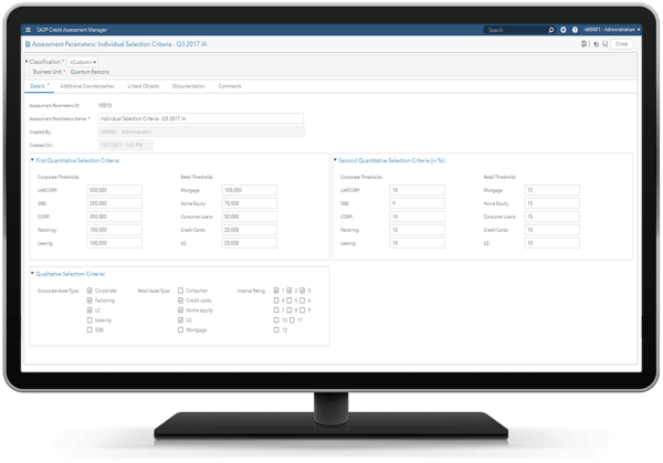 SAS Credit Assessment Manager showing assessment parameters on desktop monitor