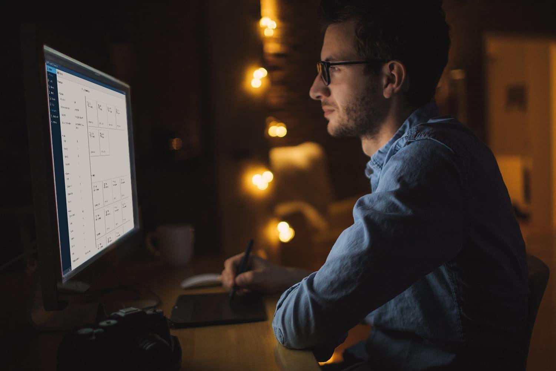 Man using SAS Grid Manager displayed on desktop monitor