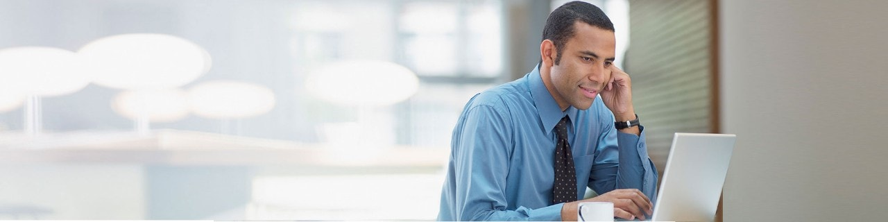 Man looking at data on his laptop