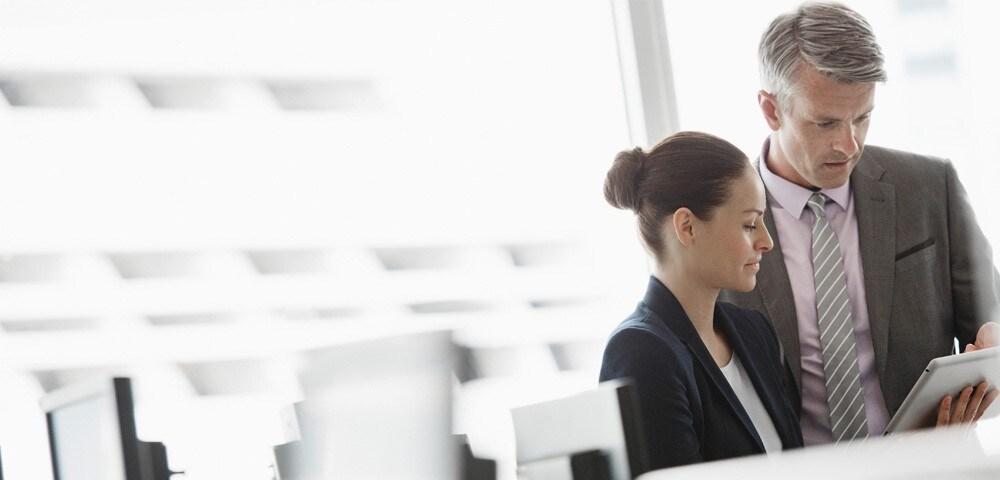 Office workers using digital tablet
