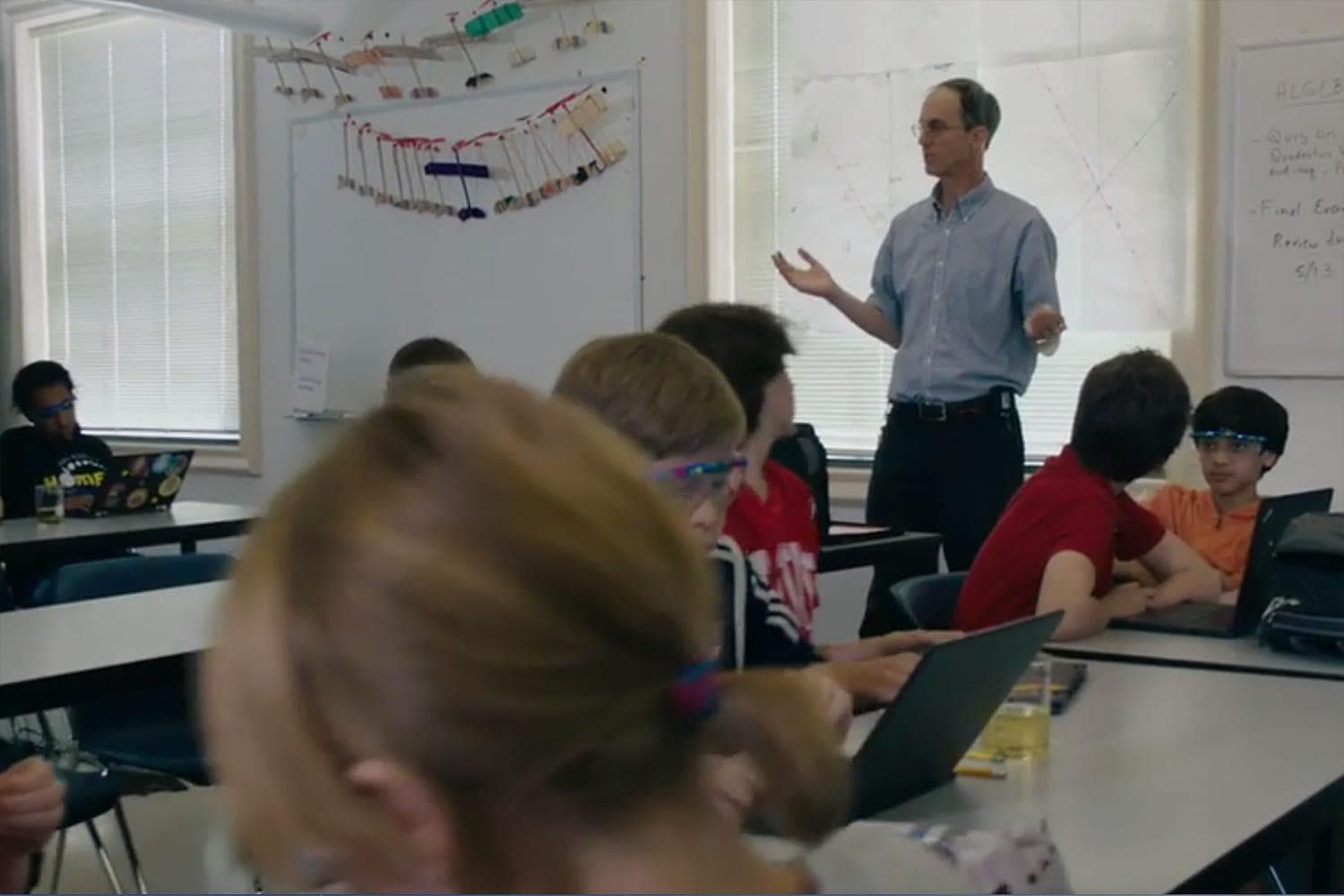 Teacher leading a discussion in classroom