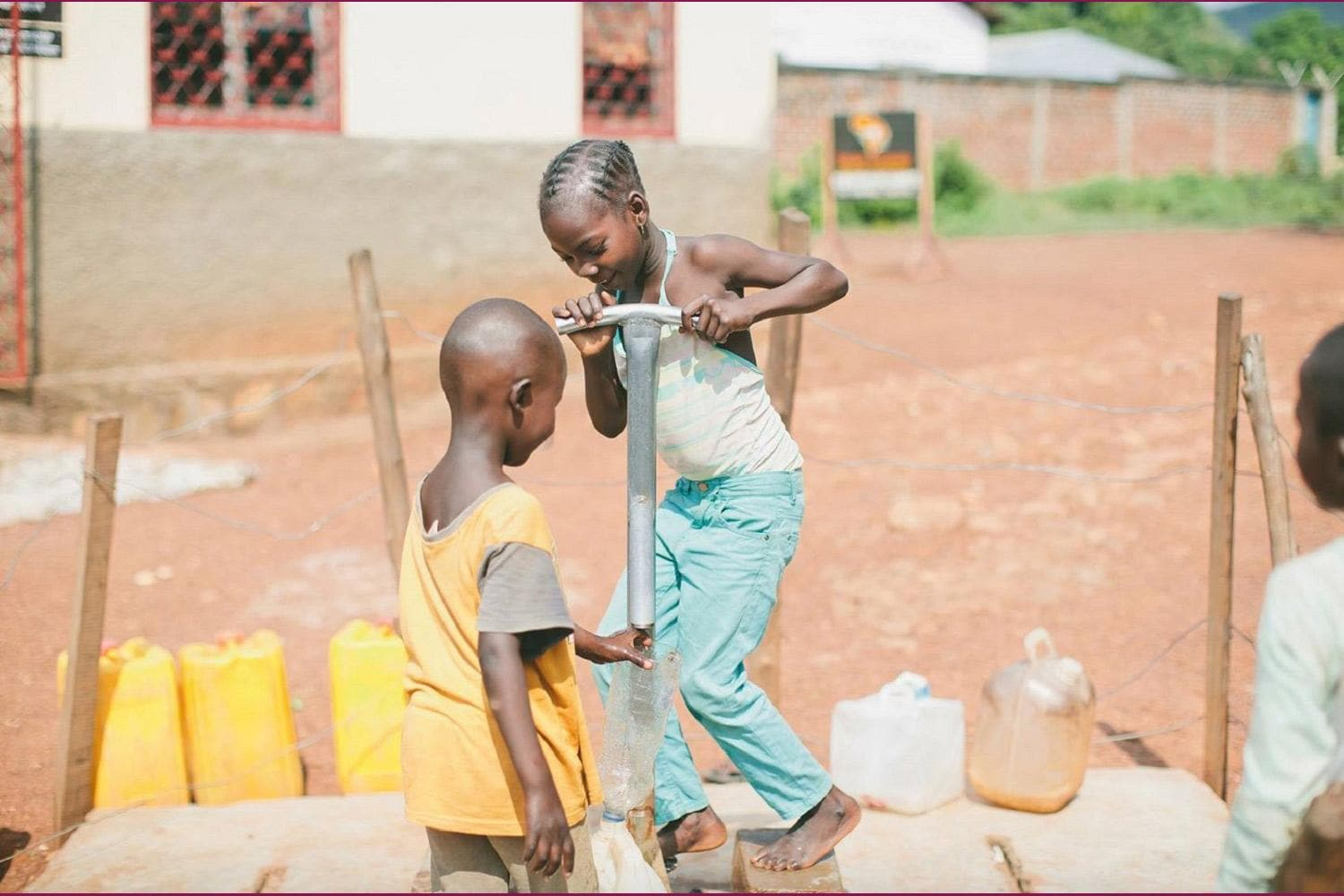 Two Kids Pumping Water from a Well