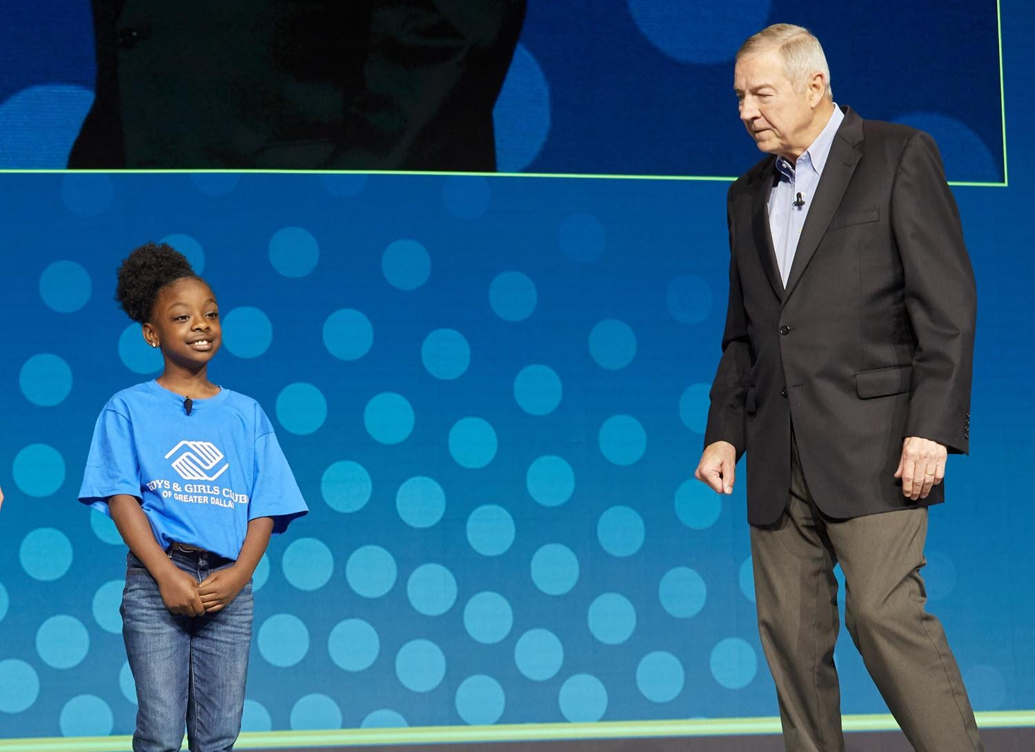 Dr. Jim Goodnight on SAS Global Forum 2019 stage with Jeneah Johnson from Boys and Girls club