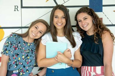 Three SAS employees smiling at camera