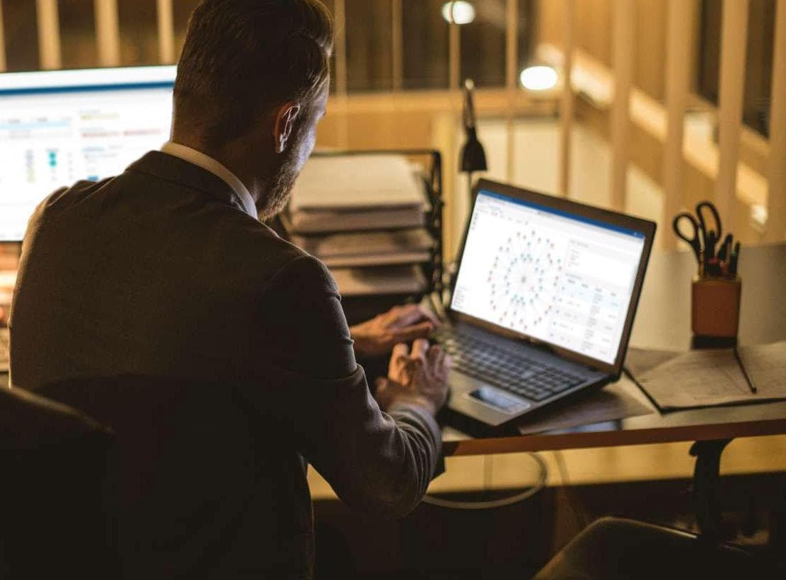 Man looking at SAS software on screen of his laptop