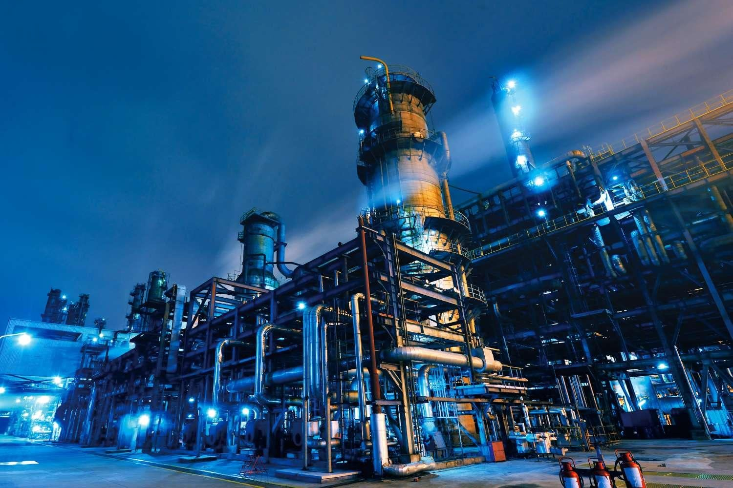 Oil Refinery Chemical Petrochemical Plant At Night