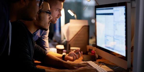 Men Analysing Data At Computer
