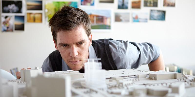 Man looking at model
