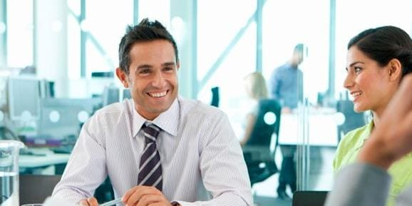 Two data scientists discussing analytics