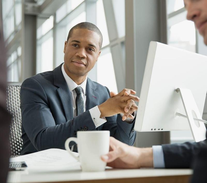 Business people meeting at desk in open office