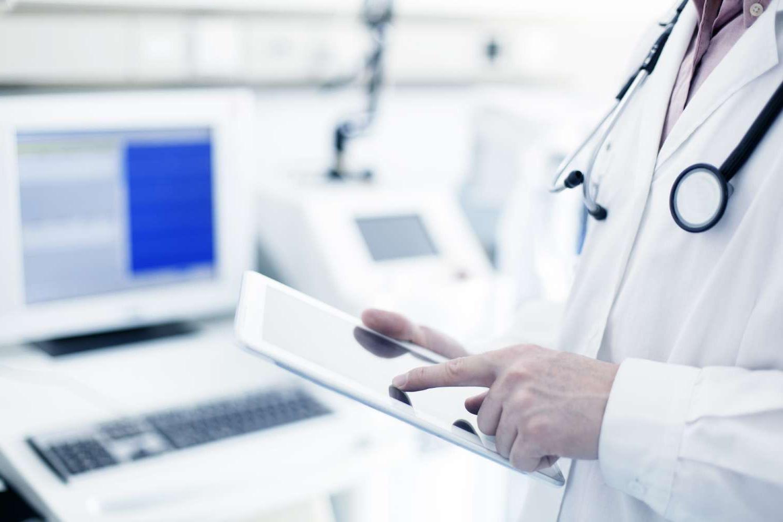 Doctor using digital tablet in hospital